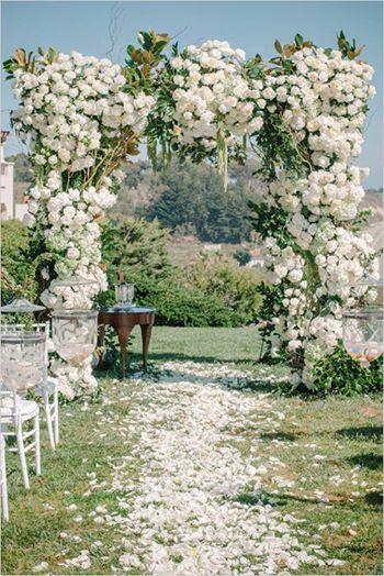Photo: A wedding lavished in florals and elegant lighting ideas you
